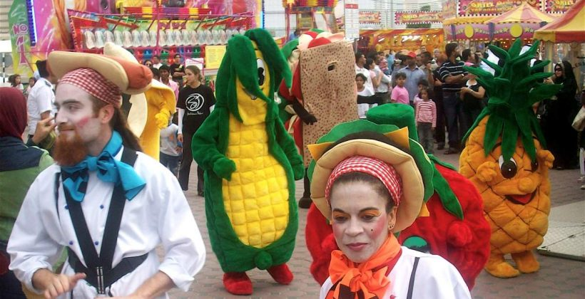 The food parade: corn, sandwich, pineapple and strawberry.