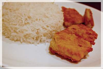 Fish steak with rice, which turned out to be fried fish with rice.