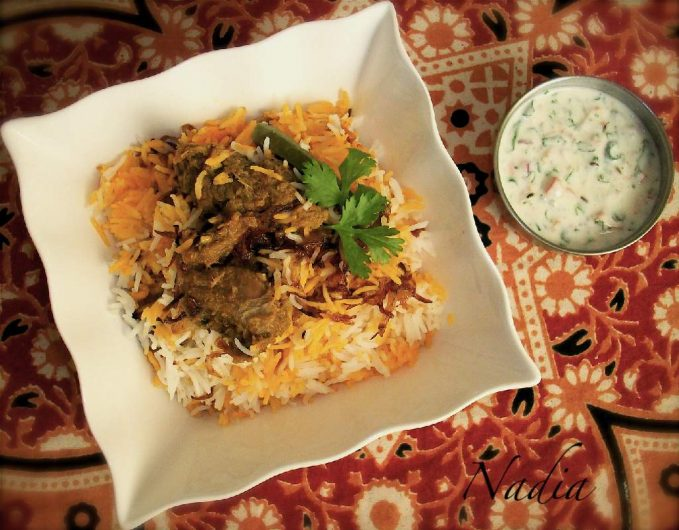 a (whisked yoghurt with salt, black pepper, chopped onions and green chillies, coriander and mint leaves).