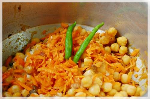 Add grated carrots and a couple of green chilies