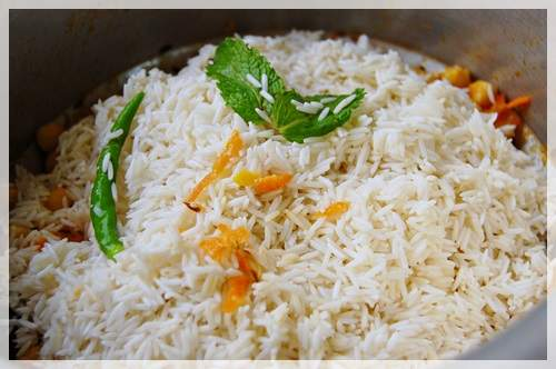 Add rice (presoaked for at least 30 minutes) and mint leaves. Fry for a minute or two.